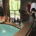 Gamble students tour inside the Applegate House. The home was designed by Fay Jones and there are n...