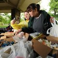 BENEVOLENCE - Sherri Calverley, left, and Kim Fort, volunteers for Northwest Arkansas Hope Center, a...