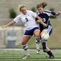 Rogers Heritage's Ricki Kimball, right, fights for the ball with Mount St. Mary's Chloe Davenport du...