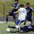 Springdale Har-Ber's Jorge Gonzalez, on ground, and Mauricio Salas, left, attack the ball as Conway'...