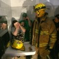 Brandy Covington, 28, talks with a firefighter as they and others take shelter Friday night in a bat...
