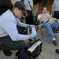 CARDIAC TRAINING - Brian Johnson, left, a Springdale paramedic, collects information from a 12-lead ...