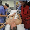 Dr. Michael Green, right, and registered nurse David Womack participate in an exercise with heart at...
