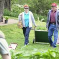 GREEN THUMBS - Corrinne and Joe Bill Morris haul a load of plants home Saturday during the Bella Vis...