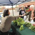 Berthalene Moore, right, and Tammie Shelley, both of Farmington, buy vegetables Saturday from Nena Y...