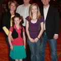 Budding comedienne Maggie Palmer, second from left, is joined by her family after her performance at...
