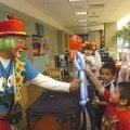 Calavarin the Clown gives Sabastion Sidon of Springdale a balloon character the clown created at the...