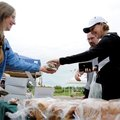 IN THE MARKET - Kim Weyhrich, left, with Olde Tyme Bakery hands Paula White and Mark Hoffman, both o...