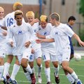 Rogers senior Erik Mora, second from right, celebrates with his teammates after a first-half goal du...