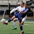 Springdale Har-Ber's Uriel Sandoval, right, kicks the ball away from Rogers High's Jose Sanchez in t...