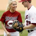 Natalie White of Van Buren receives a baseball from the University of Arkansas' Tom Hauskey after sh...