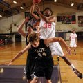 The Arkansas Wings' Aaron Ross takes the ball to the basket over Northwest Arkansas Elite's Nathan E...
