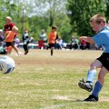 Logan Turner, 7, scores a goal off a corner kick Saturday during a soccer game at Memorial Park in B...