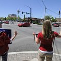 Hannah Duell and Hannah Ketter hold political signs and wave at motorists Monday in Fayetteville on ...