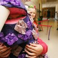 Dressed in a dragon costume, Mercedes Fanning, 7, waits in the hallway with other 1st-graders for th...