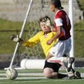 Springdale High's Santos Martinez takes a shot at the goal while Russellville keeper Kiril Paletskih...