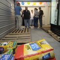 Fayetteville city officials and guests tour the new community pet food bank, Ranger's Pantry, on Mon...
