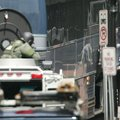 A hostage, right, is released during a bomb threat aboard a bus which cleared much of downtown Ports...