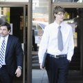 Billy Wolfe, right, walks from the Federal Courthouse on Wednesday with his lawyer, West Doss, in Fa...