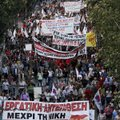 Pro communist protesters march during an anti government rally in Athens on Thursday. Greek lawmaker...