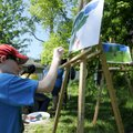 Logen Peterson, 13, left, and Hector Torres, 12, finish their landscape paintings Wednesday during L...