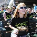 Annabelle Riley, 10, watches the Northwest Arkansas Naturals' baseball game on Wednesday with her fo...