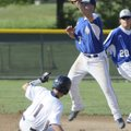 Rogers Heritage's Spanky Purdy attempts to tag out Rogers High's Alex Shelor on Thursday at Veteran...