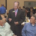 Bentonville Mayor Bob McCaslin, center, chats with Sam Pearson, left, of Bentonville and John Spenc...