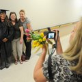 Sherine Raines, second from left, has her picture taken Thursday by her mother, Sandi Pirtle, aunts...