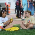 SQUARE MEAL - Christina Lowe, 10, left, and Ashetyn Burger, 10, both fourth-grade students at R.E. B...