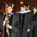 Alex Vasquez, Board of Trustees vice chairman, leads the processional Friday for the largest NorthWe...