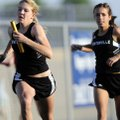 Bentonville's Lauren Tininenko, left, sprints away for the second leg of the girl's 4x100-meter rel...
