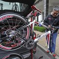 TWO-WHEELER TINKER - Jose Alcala of Chicago builds a bicycle Friday in downtown Fayetteville. Alcala...
