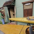 OLD TRADITION FLOATS - Skip Beaton of Fayetteville sets a model of a skin-boat Friday outside of his...