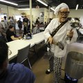 SAUCE BOSS' GUMBO GROOVE - Bill Wharton of Monticello, Fla., takes a break Friday from playing music...