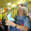 A crazy hat worn by George Lent of Rogers makes shoppers laugh Friday when they visit his balloon-fi...