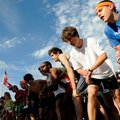 Shane Stroinski, from right, and Austin Hayes line up Saturday with other runners before the start ...