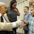 Bill Wanamaker, left, greets his great-grandchildren Wesley Martin, 5, right, and Drake Martin, 7, ...
