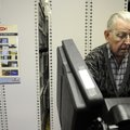 Wallace Dressler of Rogers casts his votes on an electronic voting machine Wednesday while taking a...