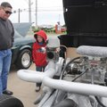 Billy Moore, left, of Gravette, talks on Saturday with his grandson Matthew Moore, 8, of Bentonvill...