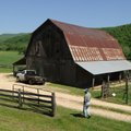Hubert Ferguson heads to his barn on his Boxley Valley land Thursday afternoon. Ferguson and others ...