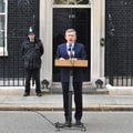 Britain's Prime Minister Gordon Brown reads a statement to the media statement outside 10 Downing St...