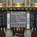 A trader watches a screen at the Stock Exchange in Madrid on Monday. Spain's Finance Ministry said S...