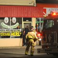 Billings Police and Fire Departments investigate the scene of a fire bomb that was thrown through th...