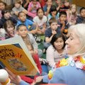 "Arkansas first lady Ginger Beebe points out illustrations as she reads ""Winston the Book Wolf"" to se..."