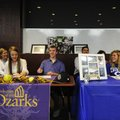 Springdale Har-Ber's Molly Bowman, from left, Allen Bowman and Alyssa Deshong smile after signing le...