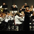 Ashley Whittle, 14, of Springdale performs a violin solo with the Arkansas Philharmonic Orchestra on...