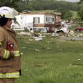 Slaughterville fire chief Paul Long surveys the damage in the mobile home community of Prairie Creek...