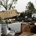 Homes are in shambles in the mobile home community of Prairie Creek Village in Slaughterville, Okla....