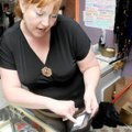 Melanie Vergura points out health warnings on a packet of K2 in her store, Hookah Java, in Rogers on...
